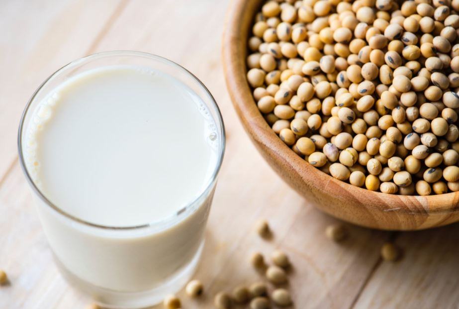 bowl of soy beans and a glass of soy milk