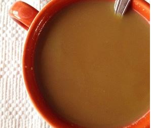 Close up of Coffee in a Red Mug Spiced with Athletic Avocado's Banana Bread Creamer
