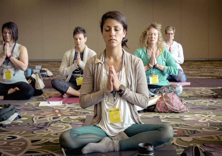 women meditating in a class