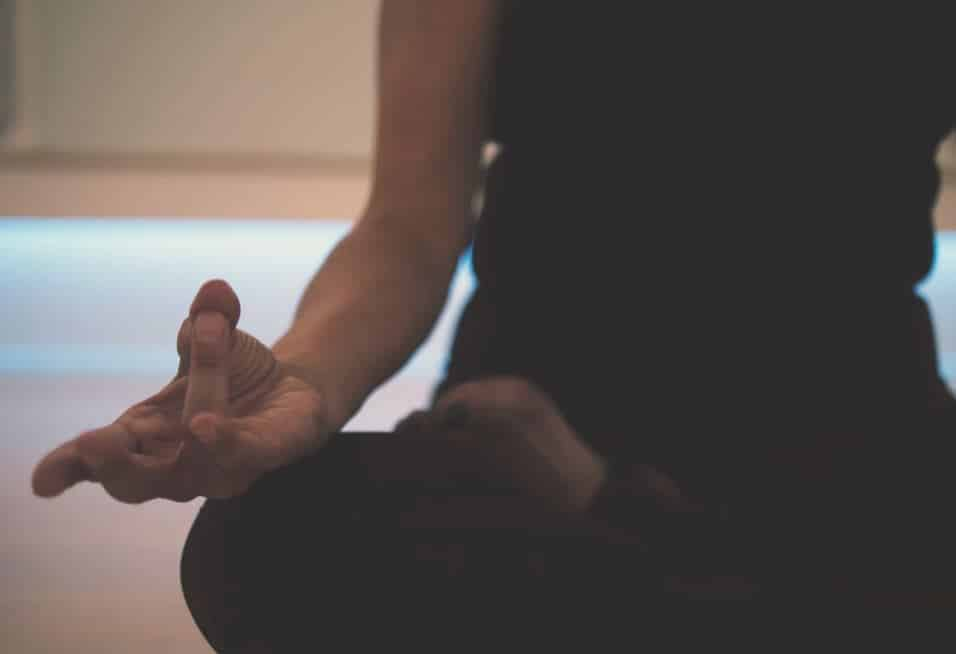 close up of a meditating woman's hand