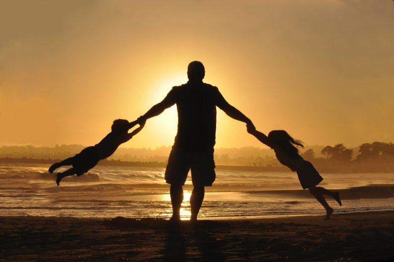dad carrying kids