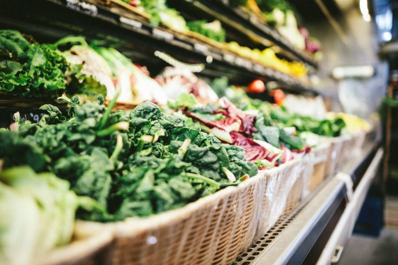 close up of leafy greens in the produce aisle of a grocery store