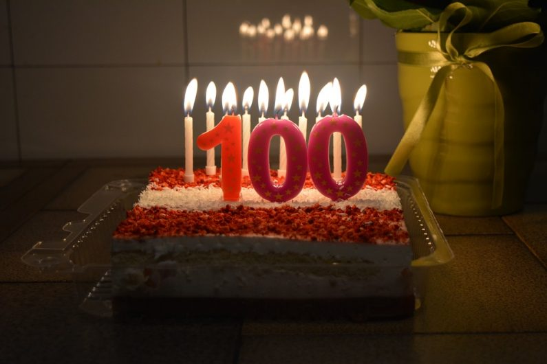 Red and White Cake with 100 Candles