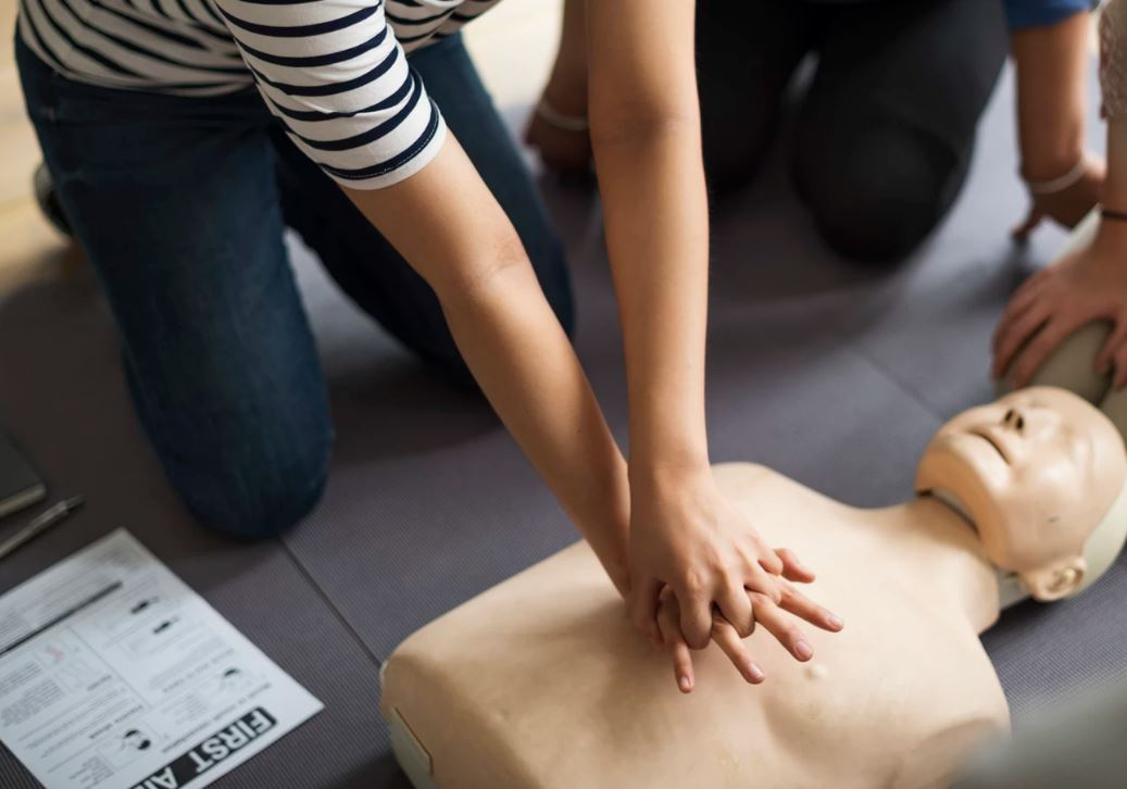 Person Performing CPR on a Mannequin