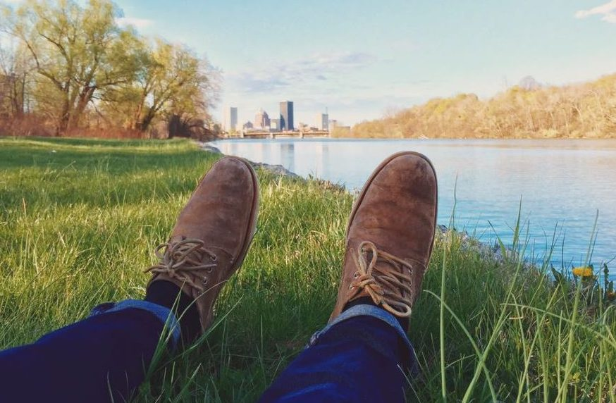 Brown Boots of Man Relaxing By A River