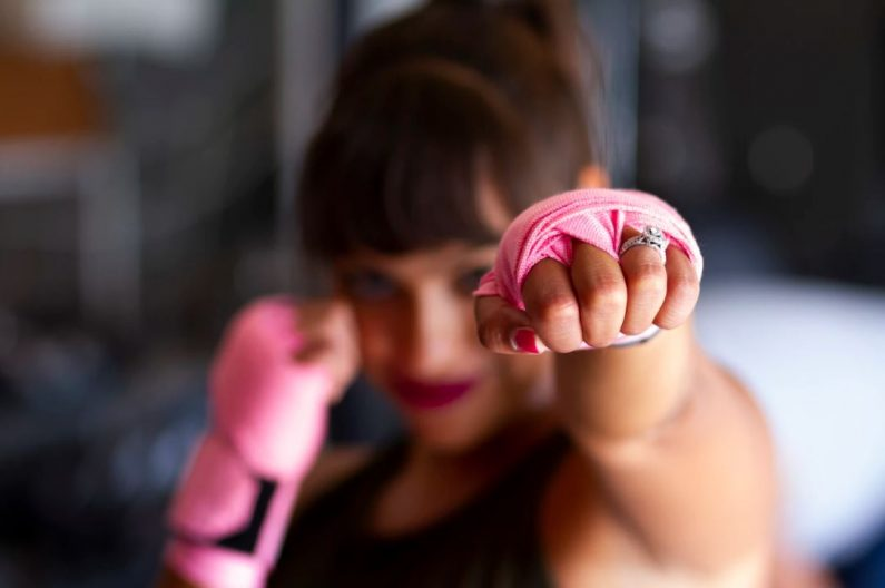 Woman with hands wrapped for boxing