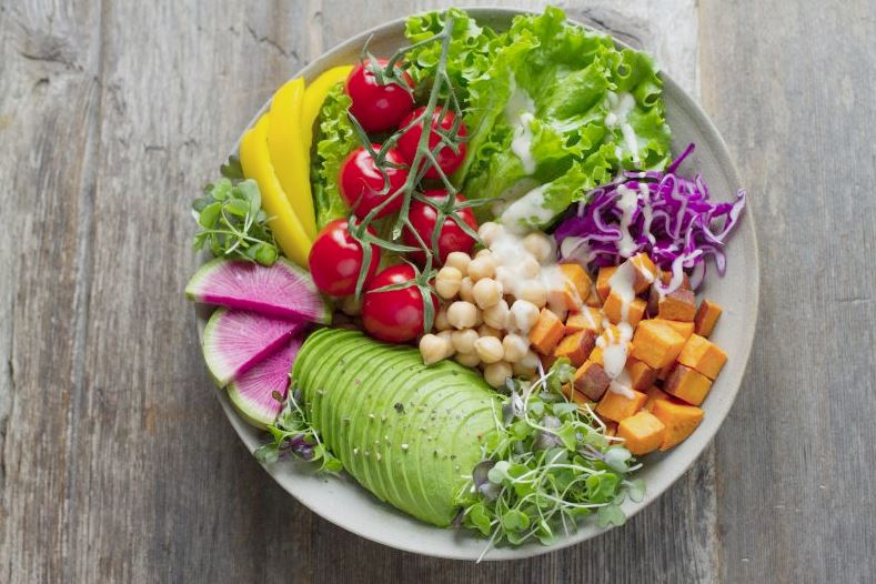 Fresh salad with avocado, chickpeas, and sweet potato