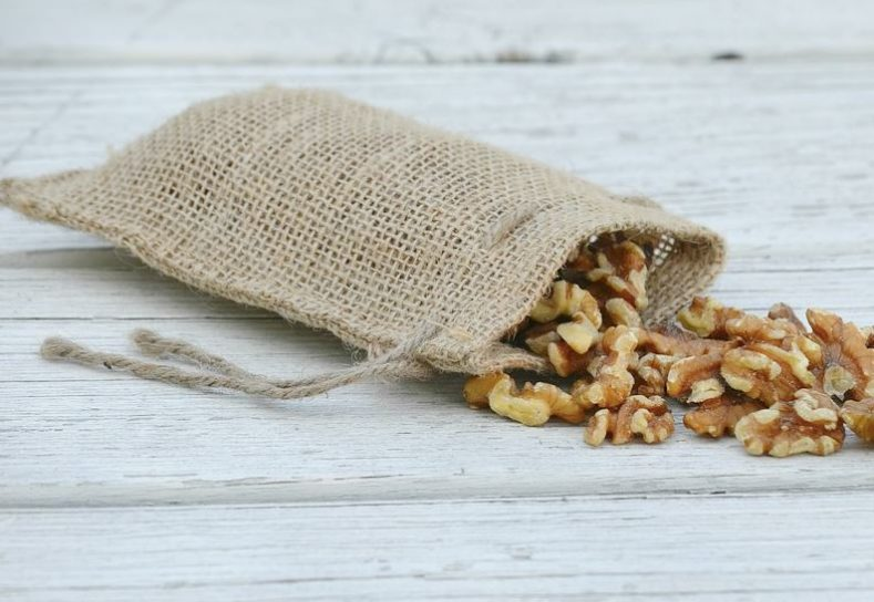 Walnuts spilling from a burlap bag
