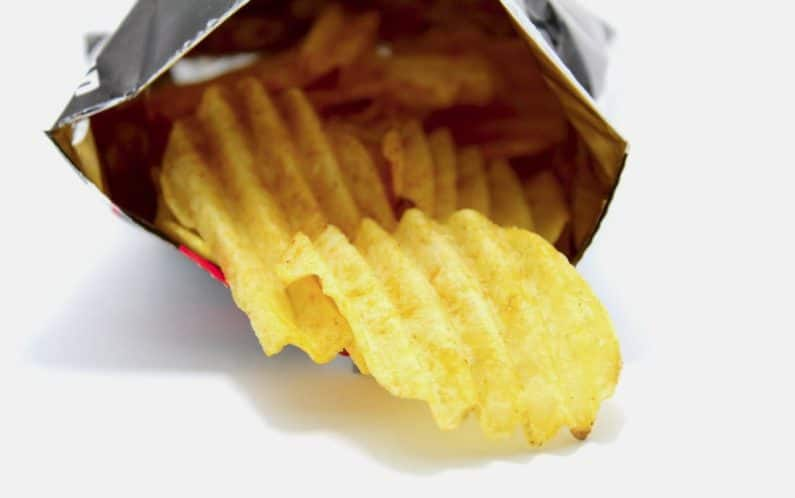 Potato chips being poured out of bag