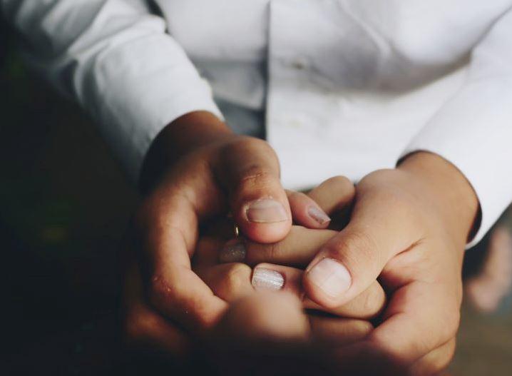 Doctor examining a patient's hands