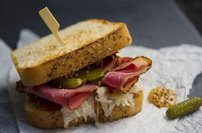 Sandwich with sauerkraut, corned beef and pickles