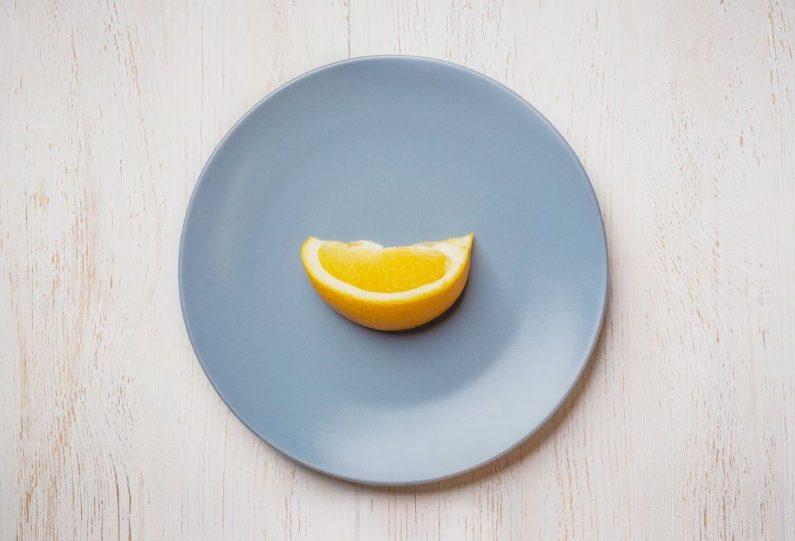 Orange slice on a blue plate