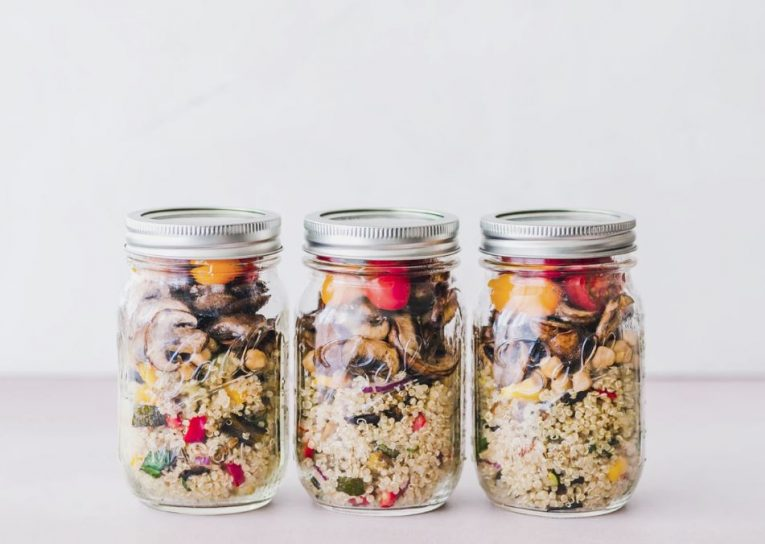 Meal prepped quinoa salads in mason jars