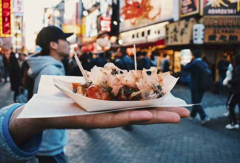 Person holding street food