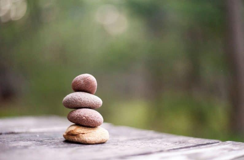 Four rocks balanced on a table