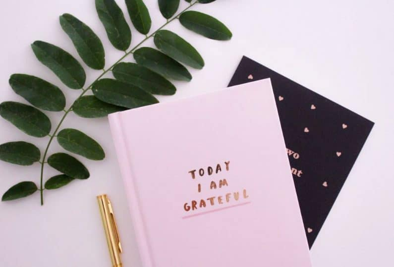 Gratitude journal on a white table